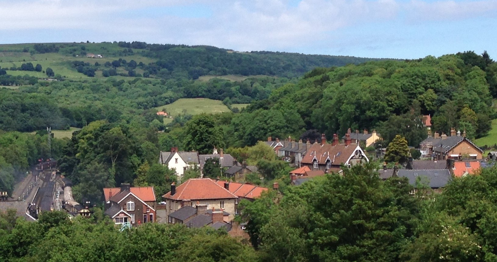 Gosmont hills and trees and village