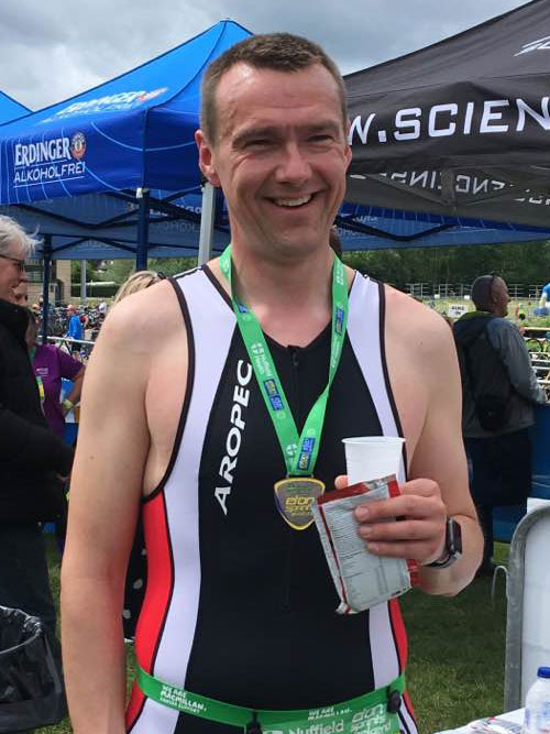 Neil Bulivant with medal after completing a triathlon