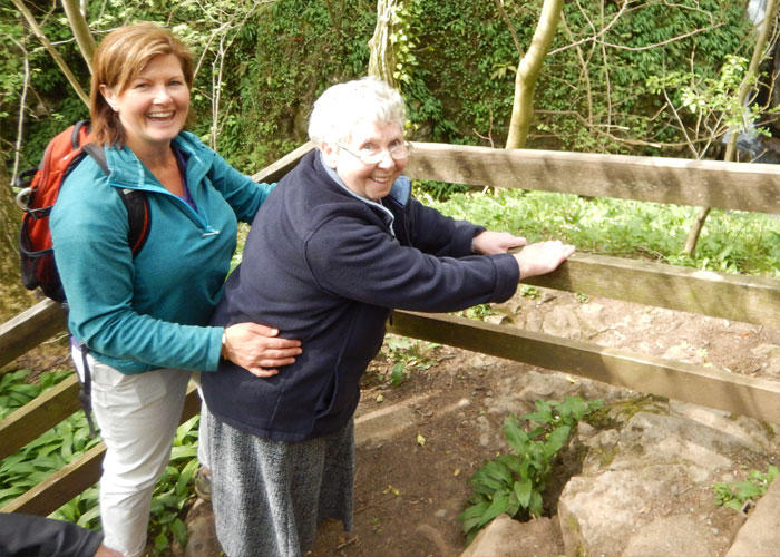 Helping an elderly lady with dementia on a walk through the woods
