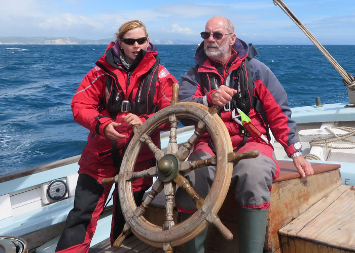 Man with dementia helping to steer a sail boat
