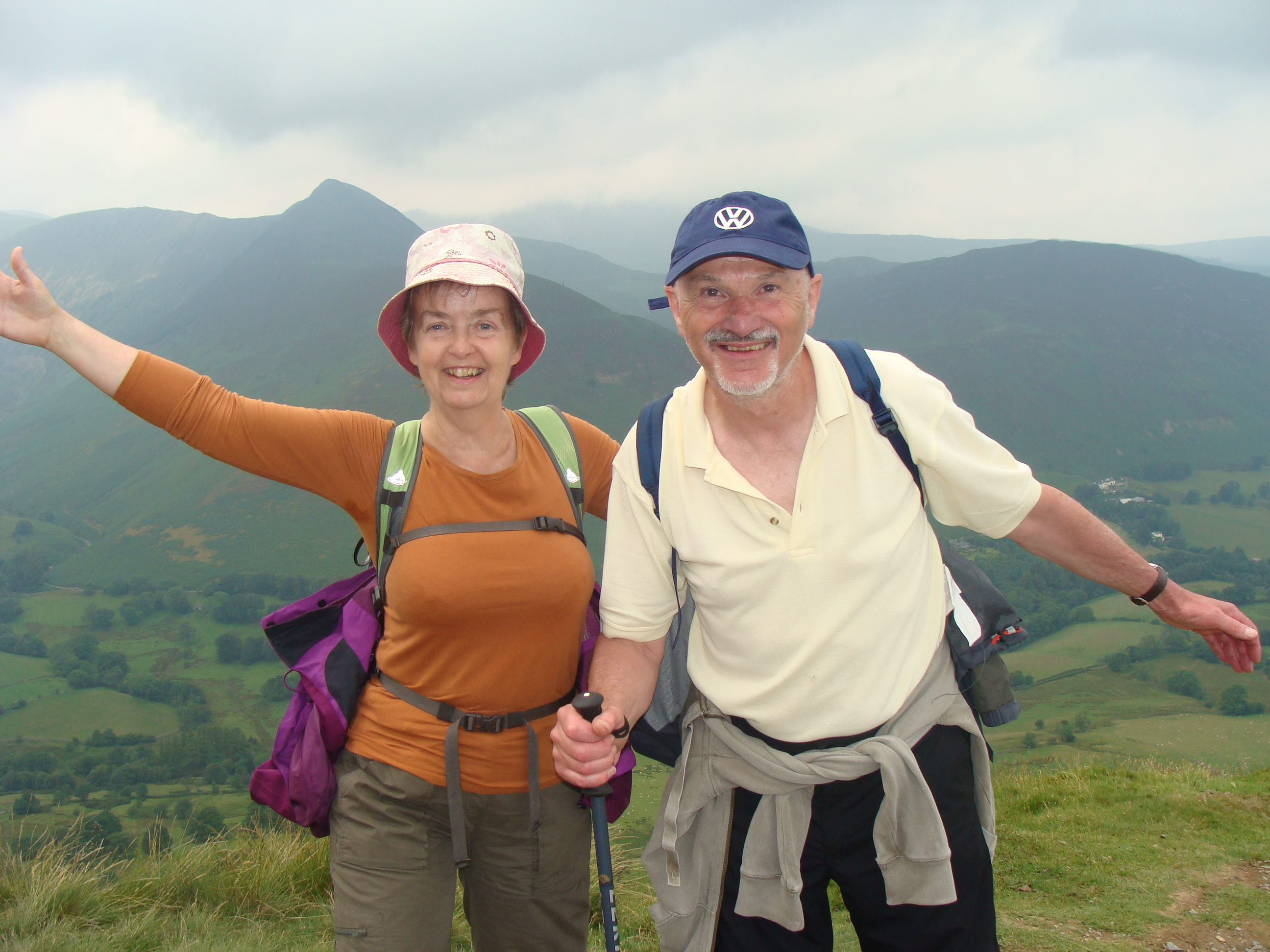 Man and Woman walking in hills