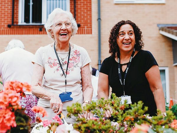 Ladies smiling at care home garden