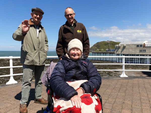 Couple & Volunteer on a quay Wales May
