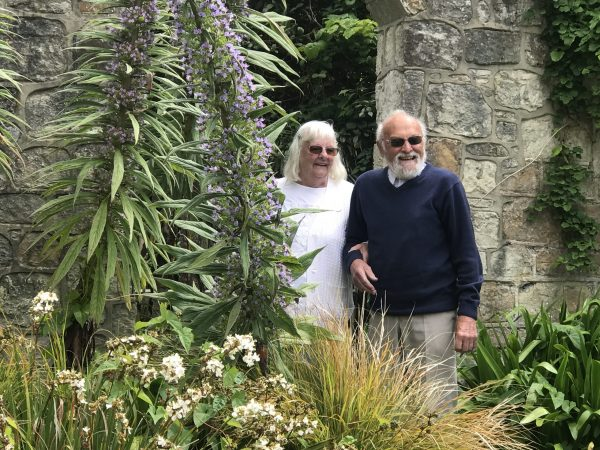 Couple in gardens with plants IOW June