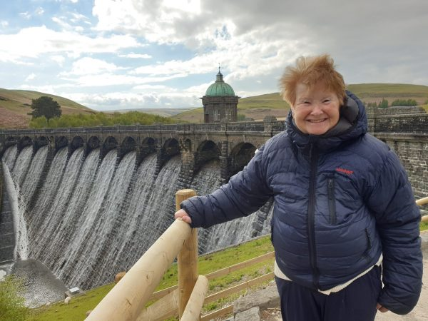 Lady with dementia smiling waterfall Wales May