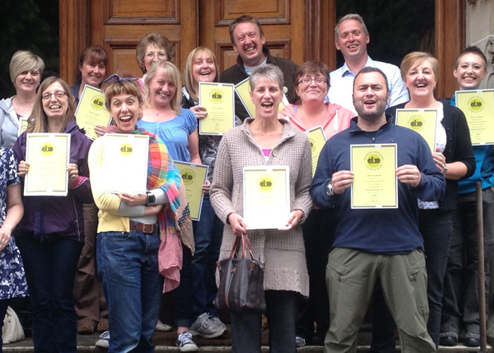 Happy group with certificates after their training