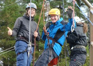man with dementia abseiling with help