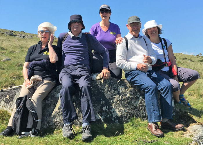 Volunteers with people with dementia on a walk in the hills